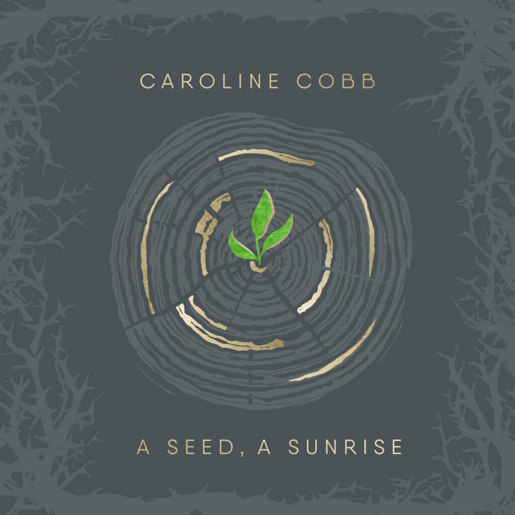 Dark blue illustration of tree trunk with gold rings, green leaves in the center, and thorns around it. Gold text - Caroline Cobb, A Seed, A Sunrise